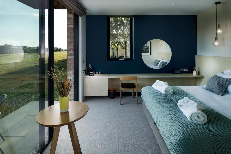 Design Engine Feldon Valley Bedroom Hotel Interior overlooking golf course